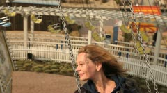 Woman on a swing ride Stock Footage