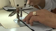 Textile Garment Factory Workers: ECU male hands and sewing machine needle Stock Footage