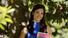 Student portrait at school, happy young woman with university books Stock Footage