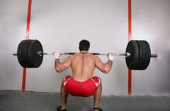 The concept of power and determination of a man lifting a weight bar.  back s Stock Photos