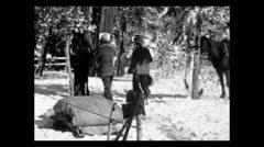 Wyoming riding out of camp in new snow 1935 B-W Stock Footage