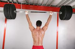Young bodybuilder training in gym.  focus in the body Stock Photos