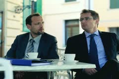 Portrait of two smiling businessmen on meeting in cafe outside - stock footage