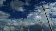Wind turbine generators on cloudy sky background Stock Footage