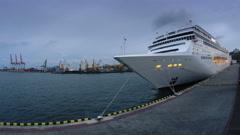 Illuminated luxury cruise liner leaves port at night timelapse, 4K Stock Footage