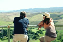 Couple standing at view-point enjoying panorama of Toscana Stock Footage