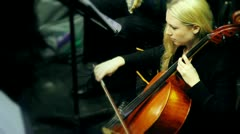 Lady cello player playing with bow Stock Footage