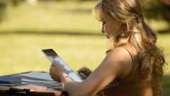 Young woman with digital tablet computer studying for college exam Stock Footage