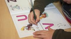 Child Writting Worksheet 001 - Timelapse Stock Footage