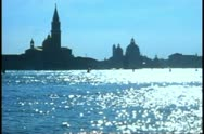 Stock Video Footage of The Grand Canal of Venice, church, dome and campanile tower, backlight