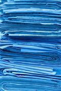 Stack of newspaper background - stock photo