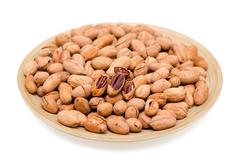 Pecans in bowl isolated on white background Stock Photos