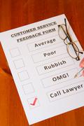Customer Service Joke Feedback Form with `Call lawyers` checked - stock photo