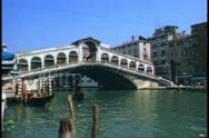 Stock Video Footage of Venice, Italy, The Rialto Bridge, The Grand Canal, wide shot