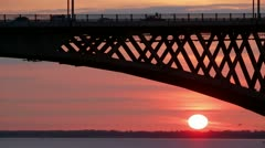 Road bridge over the river at sunset Stock Footage