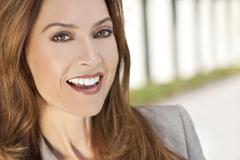 beautiful smiling woman or businesswoman in her thirties - stock photo