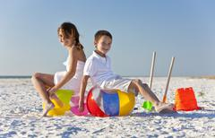 Children, boy and girl, playing on a beach Stock Photos