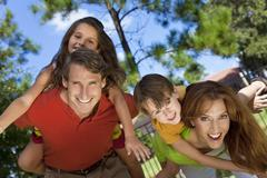 Happy family having fun outside in park Stock Photos
