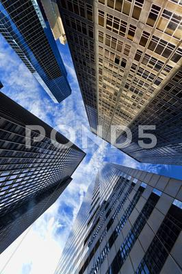 Stock photo of hdr photograph of modern office building skyscrapers & clouds