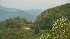 Two Motorcycles Riding in the Distance on the Blue Ridge Parkway Stock Footage
