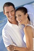 bride & groom married couple at beach wedding - stock photo