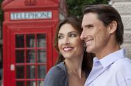 Man & woman couple in london with red telephone box Stock Photos
