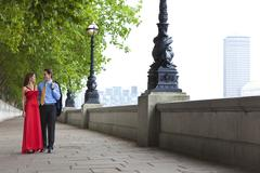 Romantic couple holding hands in london, england Stock Photos
