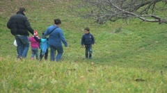 Family Climbing Down a Hill to Reach at the Lake, People in Park Stock Footage