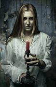 Phantom girl with candle Stock Photos