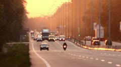 The sunset-sunrise cars traffic in the forest highway Stock Footage