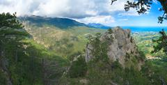 panorama from slope of aj-petri mount and christian cross on rock. - stock photo