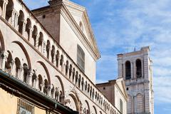 detail of facade of ferrara cathedral from piazza trento trieste - stock photo
