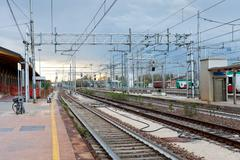The last train on railroad station in evening Stock Photos