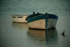 viewing a fishing boats anchored to shore - stock photo