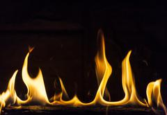 flaming log - stock photo