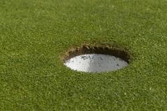 Stock Photo of golf hole closeup