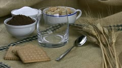 Puring Milk in a Glass Beside sugar and cocoa cups. Stock Footage