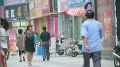Electric bicycles & motorcycles on Urban town road,China Chinese people. Stock Footage