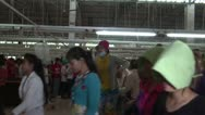 Stock Video Footage of Textile Factory Workers: sideview wide shot many workers exiting factory