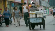Stock Video Footage of traders seller pushing a tricycle in street,on Urban town road,China Chinese pe