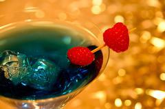 Blue cocktail with rasberry Stock Photos