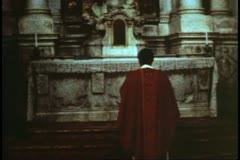 Priest in Venice, Italy at altar of Catholic Church, wide shot, grainy Stock Footage