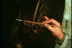 Artist in Venice, Italy restoring Titian masterpiece, close up brush - stock footage