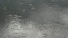 Rain making lake water ripple Stock Footage