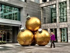 Giant Christmas Ornaments on a sidewalk - stock photo