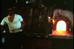 Island of Murano, Italy, glassblowers at work, worker turns bowl, pinchers - stock footage