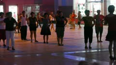 Dancing Chinese people crowd in the square at night. Stock Footage