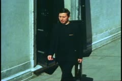Priest in Venice, Italy, young, in black, walking through streets, climb stairs Stock Footage