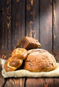 Bread on wooden boards Stock Photos