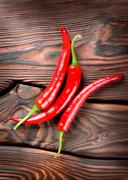 chili on a wooden background - stock photo